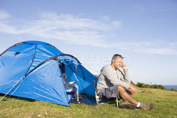 Man camping outdoors Stock photo © monkey_business