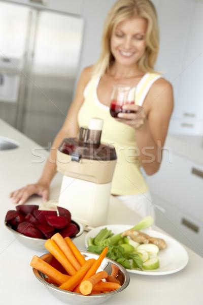 Mid Adult Woman Making Fresh Vegetable Juice Stock photo © monkey_business