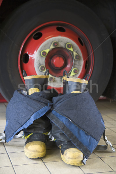 Stock photo: Firefighter's boots and trousers in a fire station