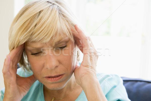 Mujer dolor de cabeza dolor enfermos altos color Foto stock © monkey_business