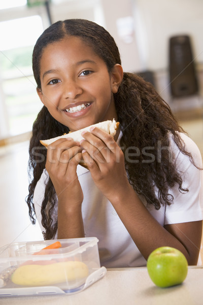 Iskolás lány élvezi ebéd iskola büfé lány Stock fotó © monkey_business