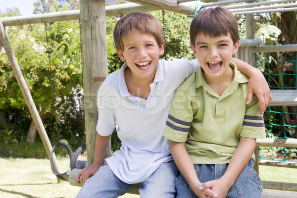 Two young male friends at a playground smiling Stock photo © monkey_business