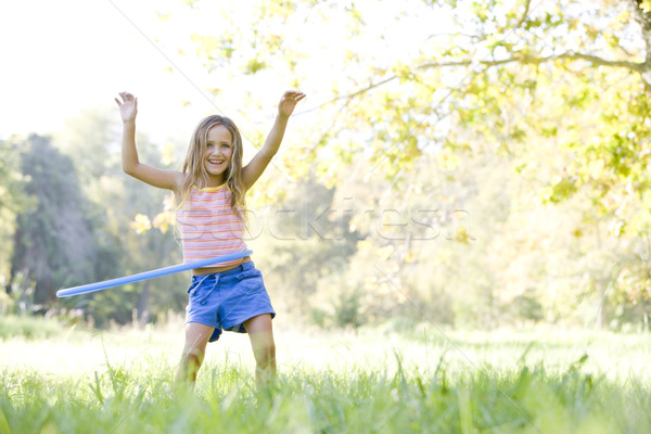 Young girl with hula hoop outdoors smiling Stock photo © monkey_business