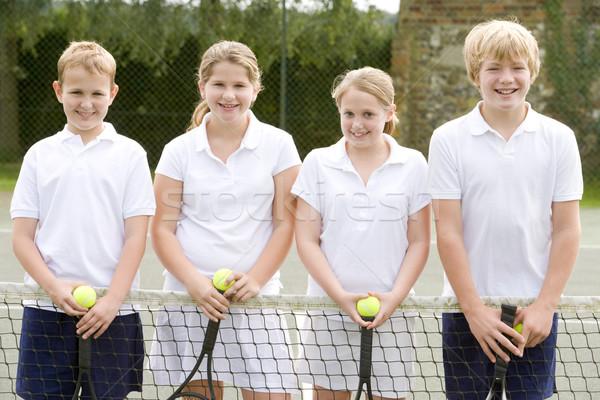 Négy fiatal barátok teniszpálya mosolyog gyerekek Stock fotó © monkey_business