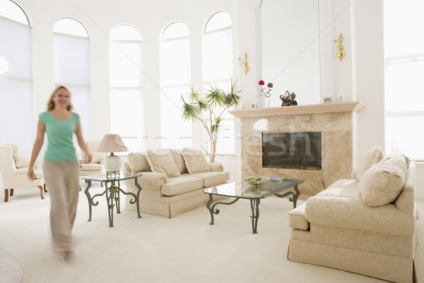 Woman walking through living room Stock photo © monkey_business
