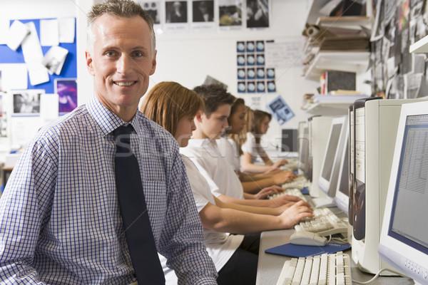 Maestro estudiar ordenador escuela educación Foto stock © monkey_business