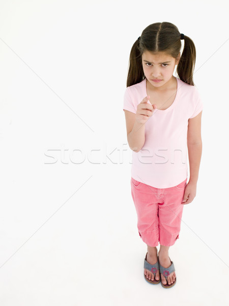 Young girl pointing and frowning Stock photo © monkey_business