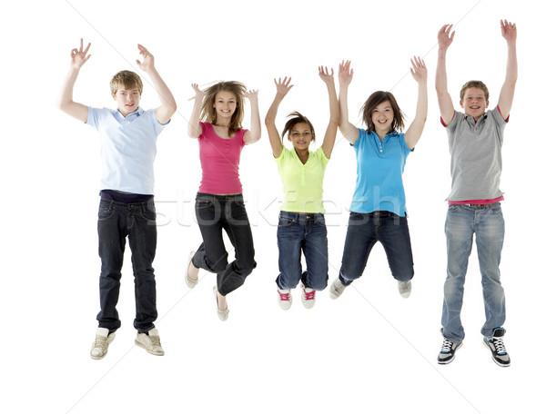 Gruppo adolescente amici jumping studio felice Foto d'archivio © monkey_business