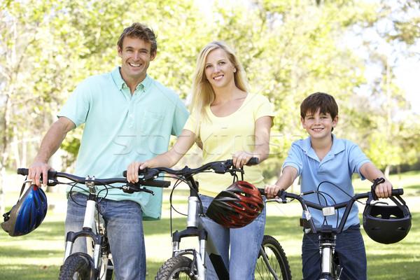 Foto d'archivio: Genitori · figlio · ciclo · parco · sorriso · uomo