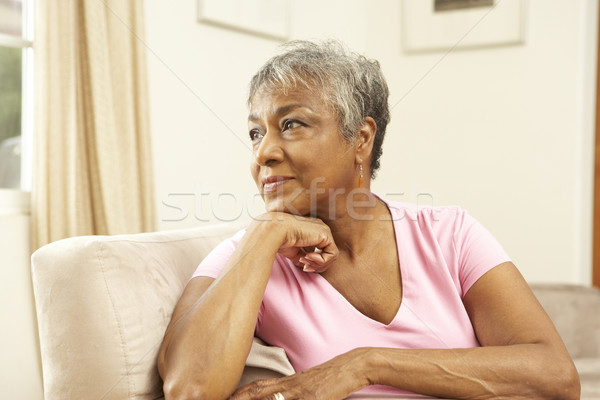 Senior Woman Looking Thoughtful In Chair At Home Stock photo © monkey_business