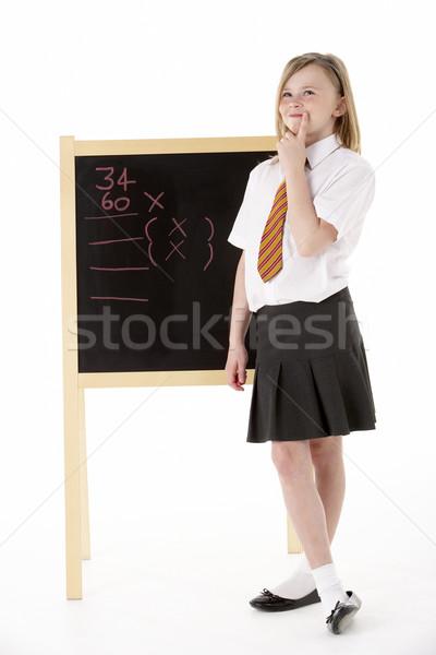 Thoughtful Female Student Wearing Uniform Next To Blackboard Stock photo © monkey_business