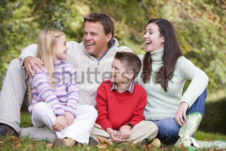 Family Group Relaxing Outdoors In Autumn Landscape Stock photo © monkey_business