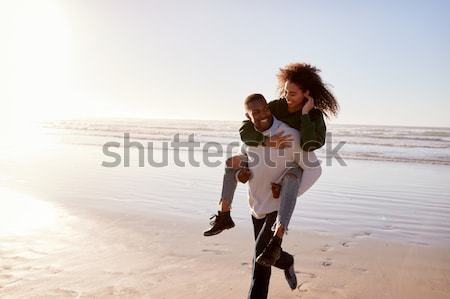Piggyback divertimento spiaggia donna mare Foto d'archivio © monkey_business