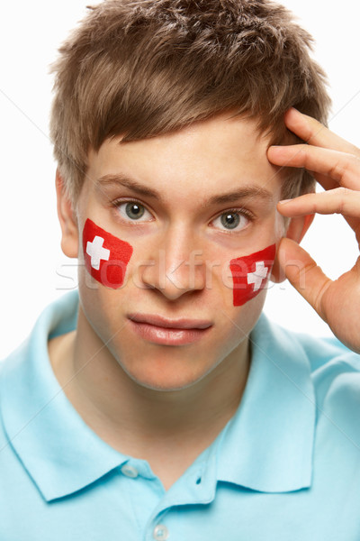 Disappointed Young Male Sports Fan With Swiss Flag Painted On Fa Stock photo © monkey_business