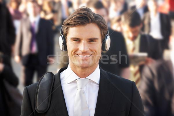 Male commuter in crowd wearing headphones Stock photo © monkey_business