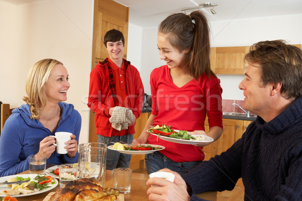 Helpful Teenage Children Serving Food To Parents In Kitchen Stock photo © monkey_business