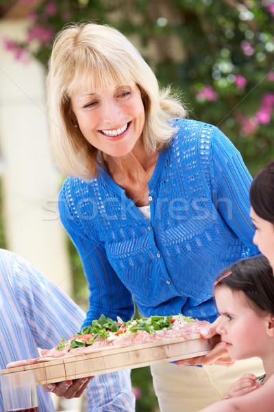Idős nő adag többgenerációs család étel férfi Stock fotó © monkey_business