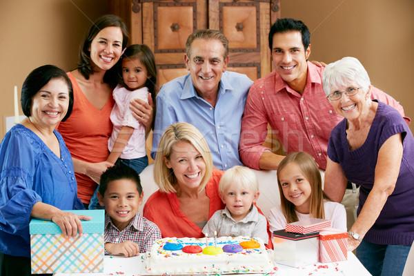 Többgenerációs család ünnepel születésnap család lány torta Stock fotó © monkey_business