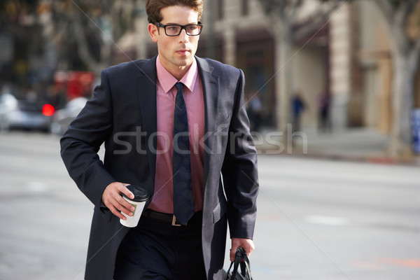 Businessman Hurrying Along Street Holding Takeaway Coffee Stock photo © monkey_business