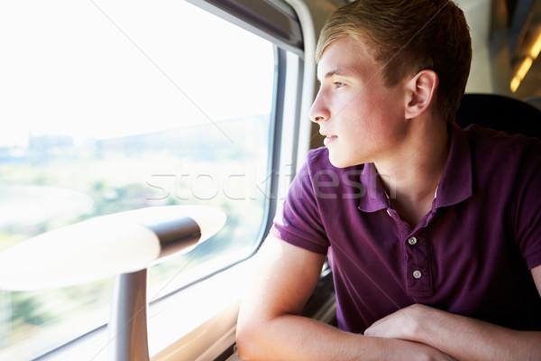 Fiatalember megnyugtató vonat utazás boldog férfiak Stock fotó © monkey_business