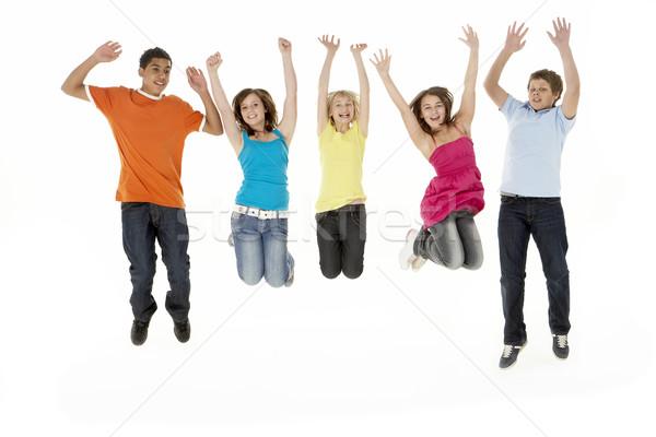 Grupo cinco jovem crianças saltando estúdio Foto stock © monkey_business
