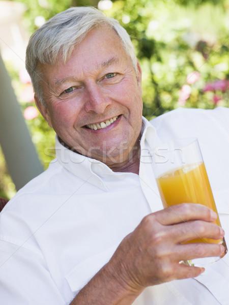 Senior man enjoying glass of juice Stock photo © monkey_business