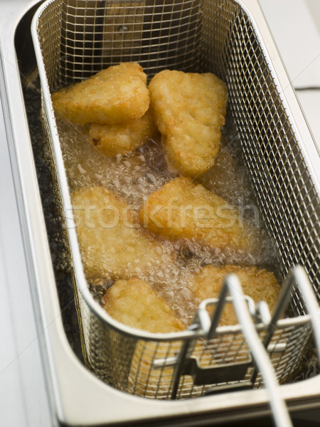 Hash Browns being Deep Fried in Corn Oil Stock photo © monkey_business