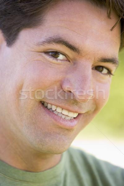 Stock photo: Head shot of man smiling