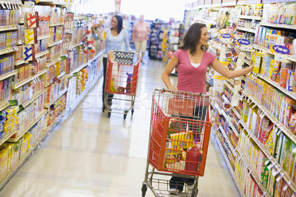 Two women shopping in supermarket Stock photo © monkey_business