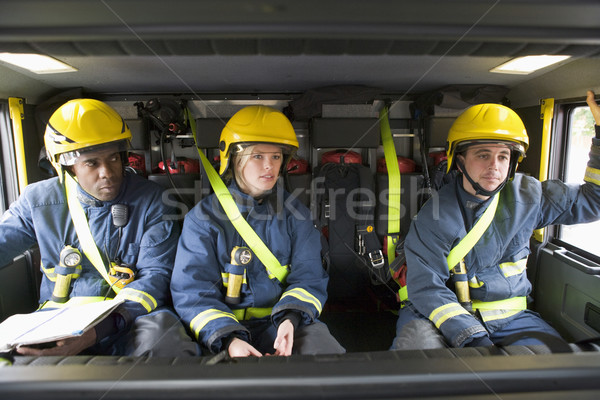 Firefighters on their way to an emergency scene Stock photo © monkey_business