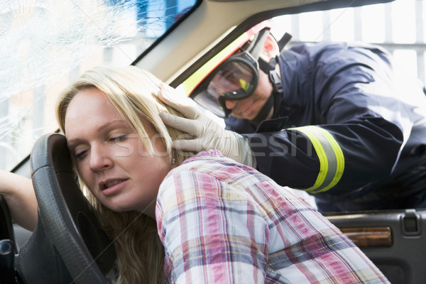 Firefighters helping an injured woman in a car Stock photo © monkey_business