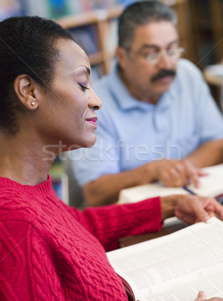 Mature students studying in library Stock photo © monkey_business