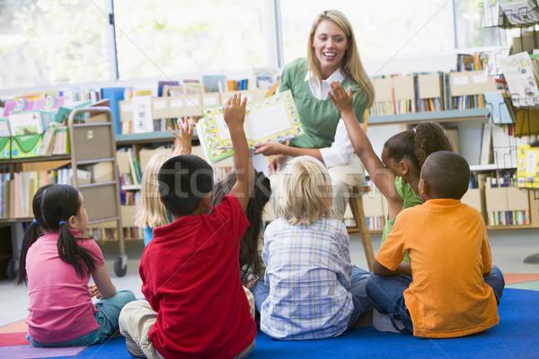 детский сад учитель чтение детей библиотека женщину Сток-фото © monkey_business