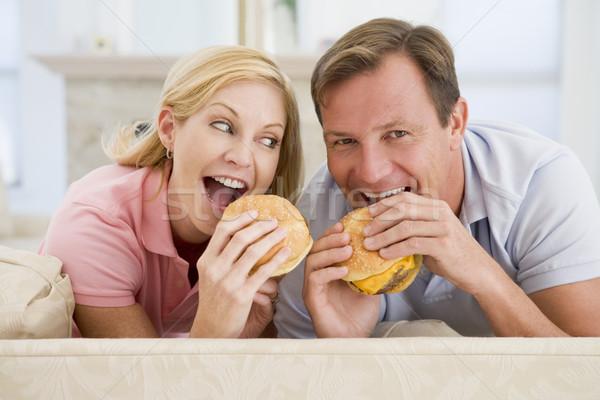 Couple Enjoying Burgers Together Stock photo © monkey_business