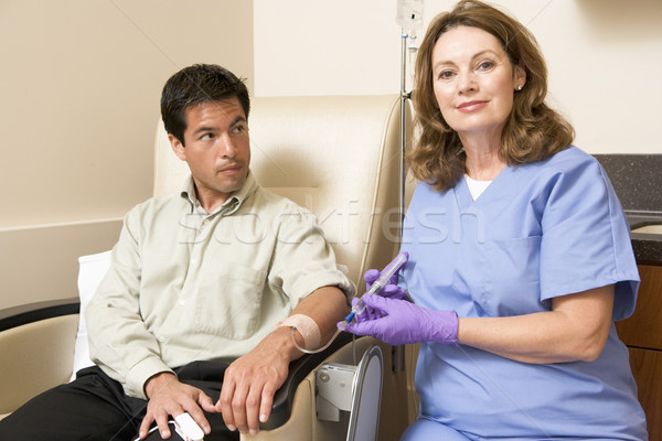 Nurse Giving Patient Injection Through Tube Stock photo © monkey_business