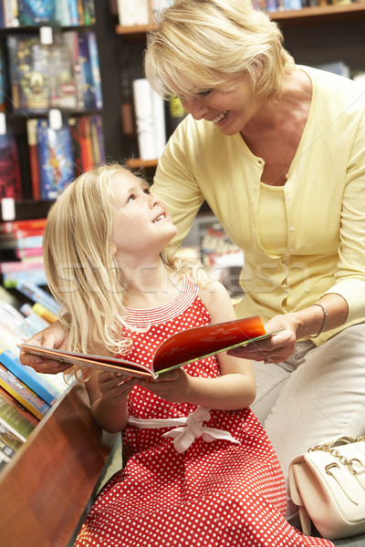 Grandmother and grandaughter in bookshop Stock photo © monkey_business