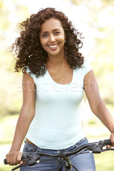 Woman Riding Bike In Park Stock photo © monkey_business