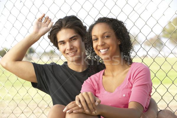Adolescente casal sessão recreio mulher homem Foto stock © monkey_business
