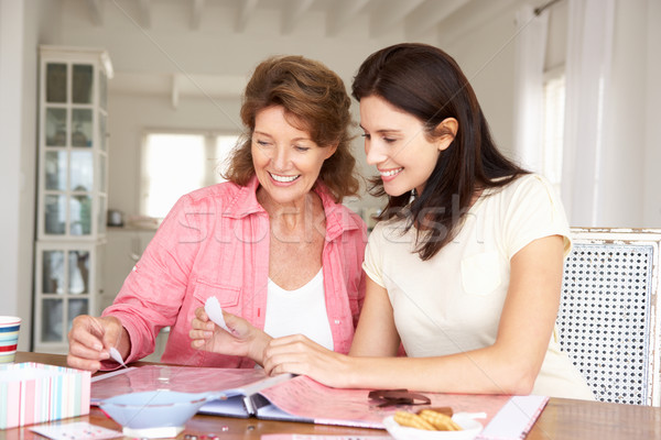 Adult mother and daughter scrapbooking Stock photo © monkey_business