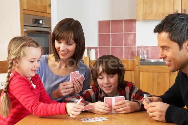 Family Playing Cards In Kitchen Stock photo © monkey_business