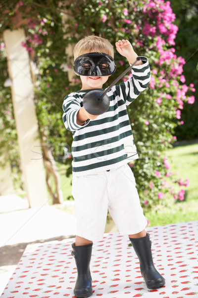 Young Boy Wearing Wellington Boots And Fancy Dress Costume Stock photo © monkey_business
