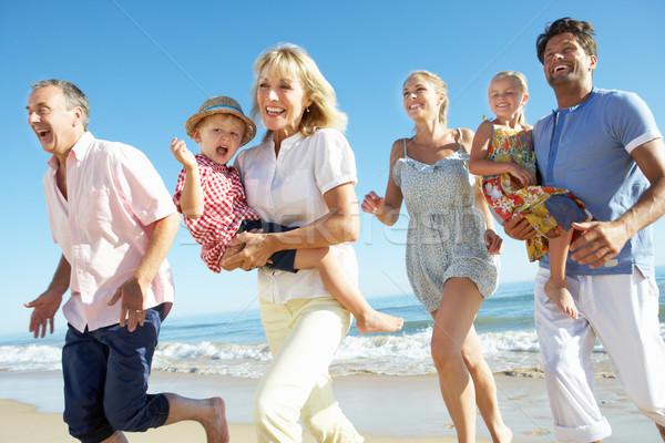 Multi Generation Family Enjoying Beach Holiday Stock photo © monkey_business