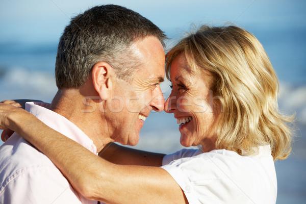 Senior Couple Enjoying Romantic Beach Holiday Stock photo © monkey_business