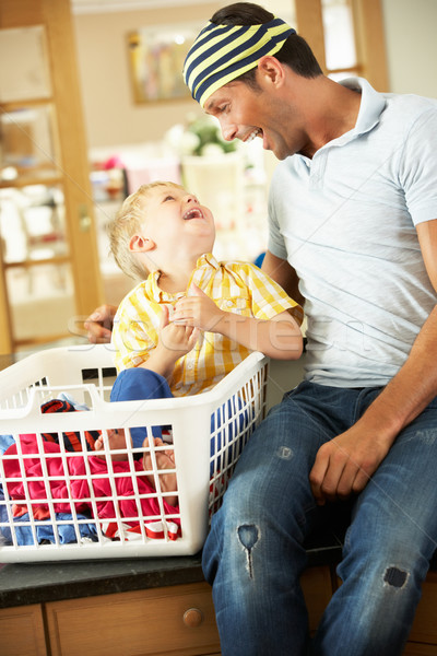 Father And Son Sorting Laundry Sitting On Kitchen Counter Stock photo © monkey_business