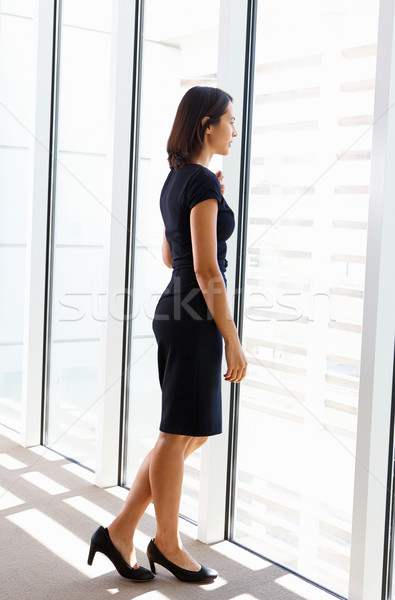 Businesswoman Looking Out Of Office Window Stock photo © monkey_business