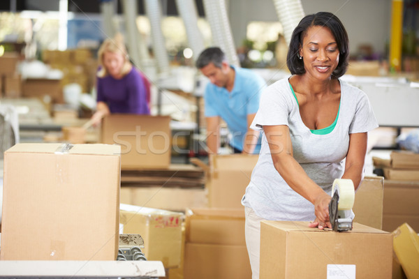 Workers In Warehouse Preparing Goods For Dispatch Stock photo © monkey_business