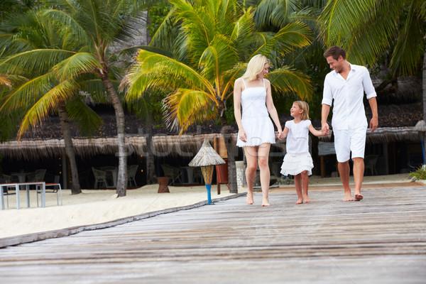 Family Walking On Wooden Jetty Stock photo © monkey_business