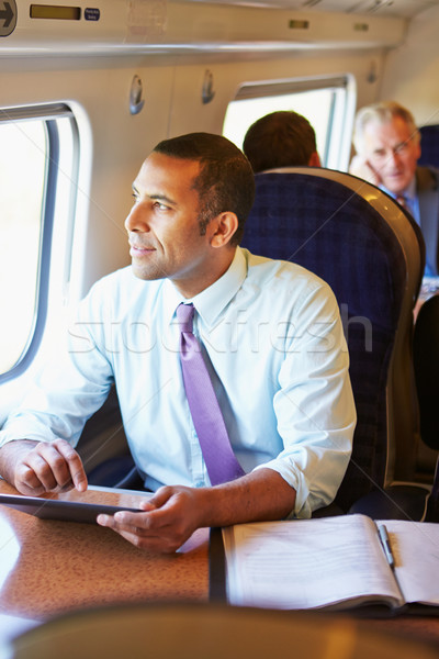Businessman Commuting On Train Using Digital Tablet Stock photo © monkey_business
