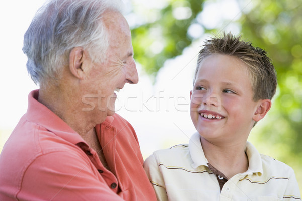 Grandfather and grandson smiling outdoors. Stock photo © monkey_business