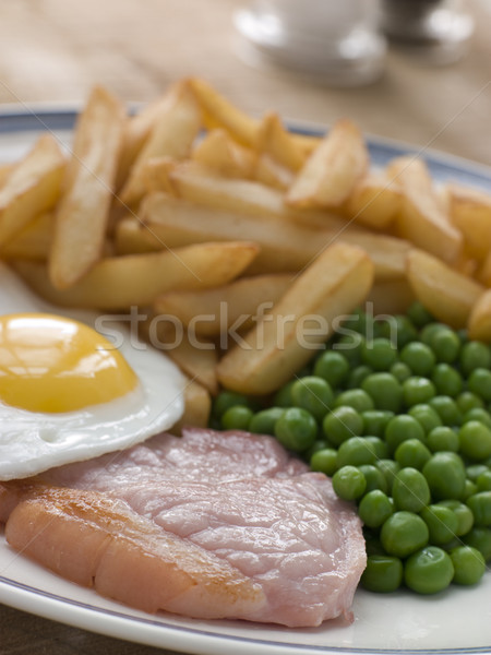 Filete huevo frito chícharos chips huevos placa Foto stock © monkey_business